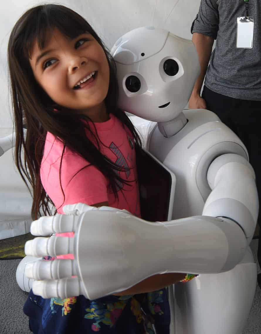 Yaretzi Bernal, 6, with Pepper, the emotional robot from Japan
