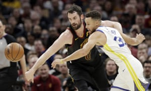 Kevin Love and Stephen Curry battle for the ball