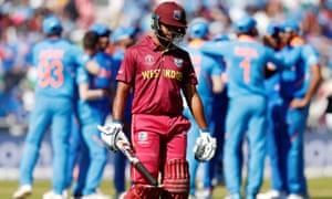 West Indies' Nicholas Pooran looks dejected as he walks off after losing his wicket.