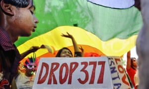 Participants hold a placard demanding the repeal of Section 377 of the Indian penal code, which bans homosexuality.