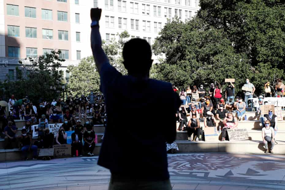 Protesters gather at Frank Ogawa Plaza in Oakland for a peaceful sit-in and march in the wake of George Floyd's death on June 4, 2020.