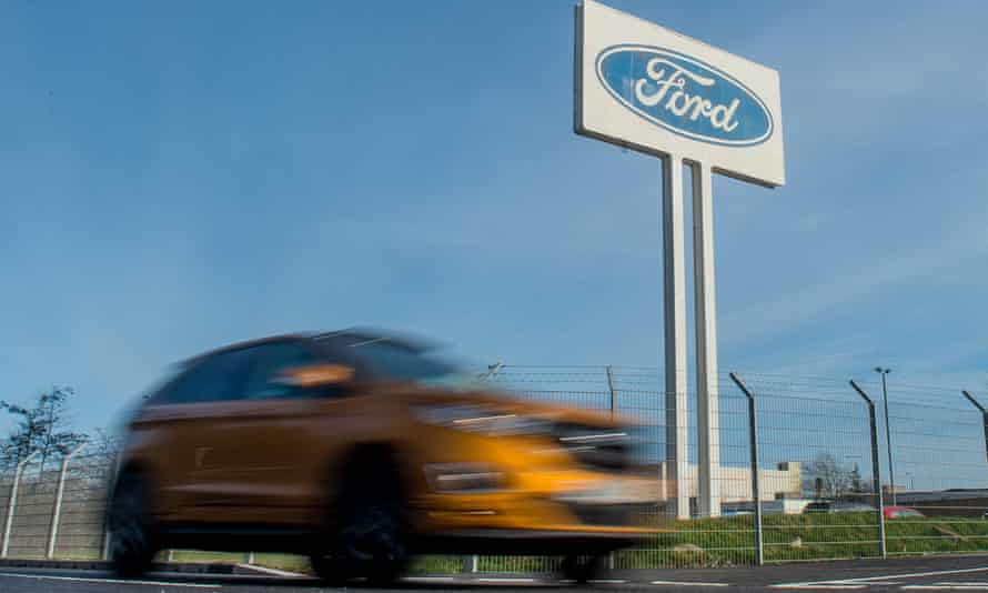 a car speeds by the Ford engine plant at Bridgend, Wales