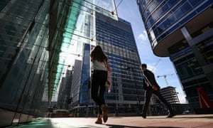 Pedestrians walk past the European Medicines Agency, which employs 900 people in Canary Wharf, London.