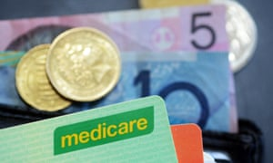 Australian bank notes and coins with a Medicare card