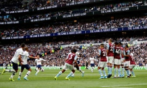 Tottenham's Christian Eriksen takes a free-kick that was saved by Aston Villa's Tom Heaton .