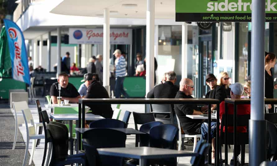 People enjoy outside cafe dining at the Maunganui main beach in Tauranga after restrictions were eased.