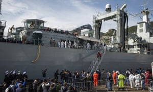 Rescued migrants disembark from the Spanish navy ship Cantabria in Salerno, Italy.