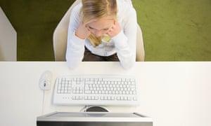 Young woman staring at computer