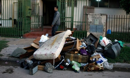 A resident of the Villa Mitre slum and his belongings ruined by the 2013 floods in Buenos Aires.