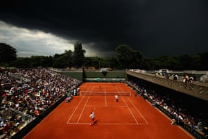 Paris, FranceDark clouds gather above the French Open men's doubles match between Sam Groth of Australia and Robert Lindstedt of Sweden and Bob Bryan and Mike Bryan of the US at Roland Garros.