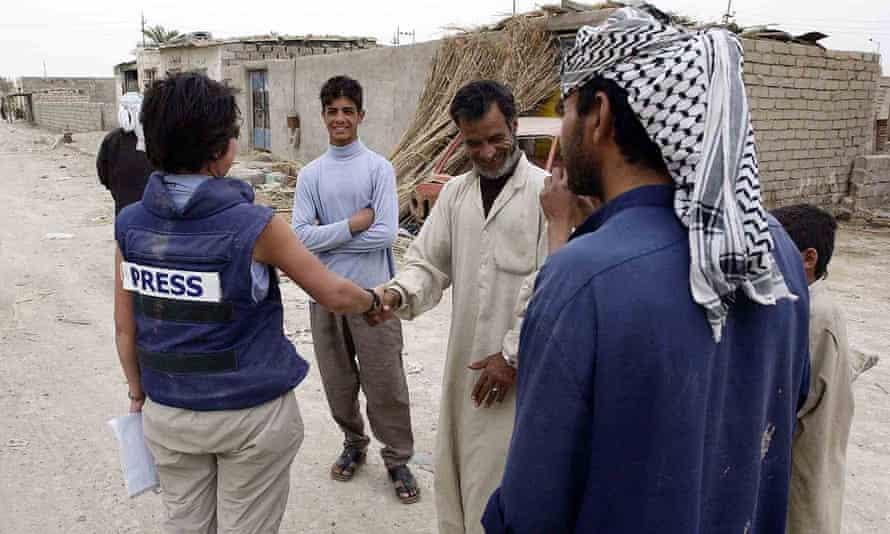 Audrey Gillan talks to villagers in Iraq