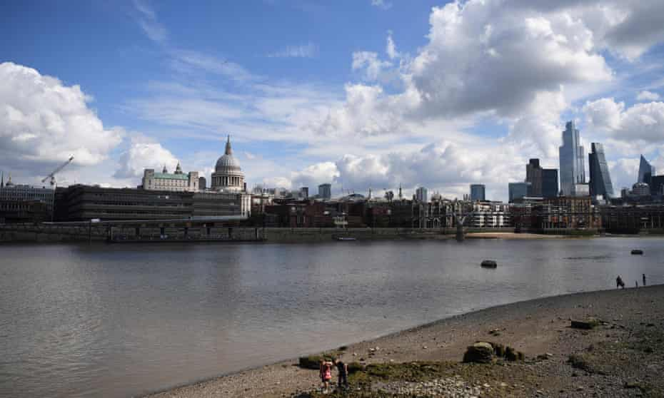 a mudlark looks for items of historic interest on the foreshore of the Thames.