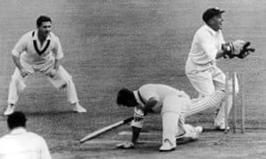 Australia's Wally Grout attempts to stump Roy Swetman of England in the third Ashes Test at Sydney in 1959.