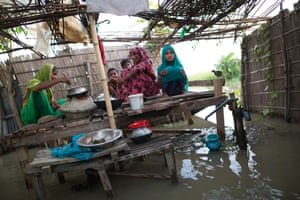 Family in Bangladesh cooking in a flood affected area