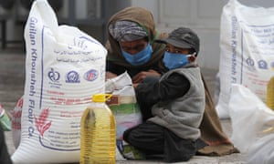 A family receives food rations amid lockdown in Herat, Afghanistan.