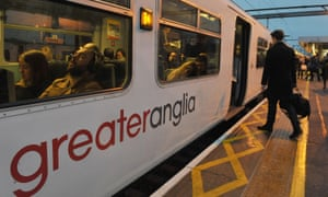 Commuters board a Greater Anglia train at Shenfield in Essex