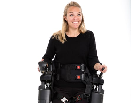 TV presenter Sophie Morgan walking with the aid of Rex, a hands-free robotic walking device.