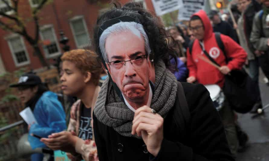 A demonstrator wears a mask of Eduardo Cunha