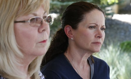 Caren Teves, right, who lost her son Alex in the 2012 Aurora movie theatre massacre, sits with Sandy Phillips, left, whose daughter Jessica Ghawi was killed in the attack, in Centennial, Colorado on 16 July 2015.