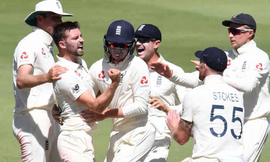 Mark Wood (second left) and Ollie Pope celebrate a wicket during the fourth Test against South Africa at the Wanderers in January