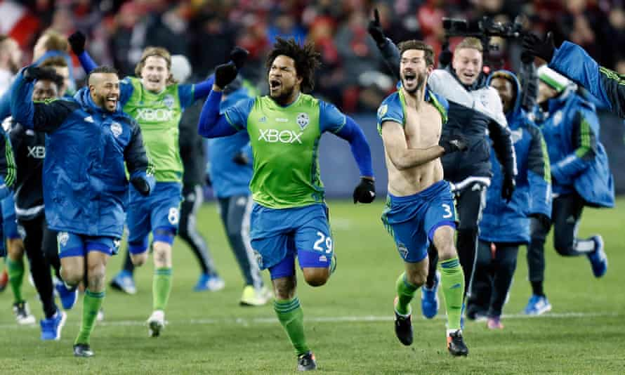 Seattle Sounders defender Roman Torres celebrates his winning penalty.