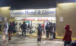 Looters run out of a store in Ferguson