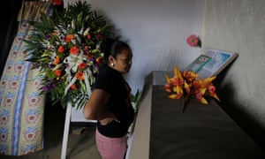 A woman looks at the coffin of Nelson Espinal during his funeral in Tegucigalpa, Honduras.