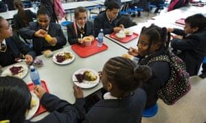 Children eating school lunch