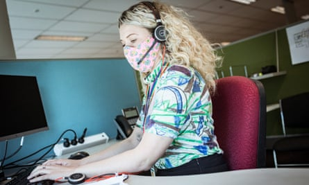 blonde woman with headset at computer