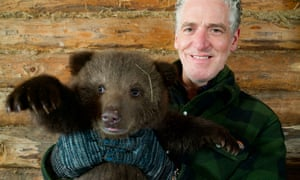 Gordon Buchanan with orphaned bear cub Pasha.