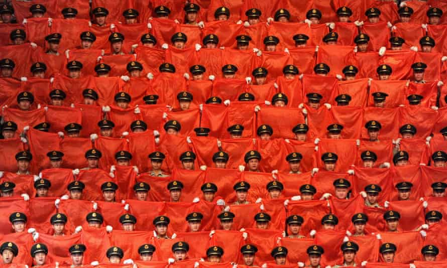 A choir sings 'red songs' on stage to mark the 90th Anniversary Of The Communist Party Of China on June 30, 2011