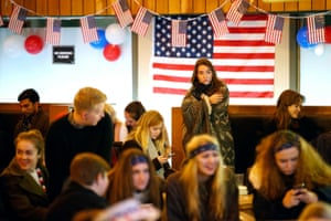 Students attend a US election party at the University of Edinburgh to watch the culmination of the battle for the White House