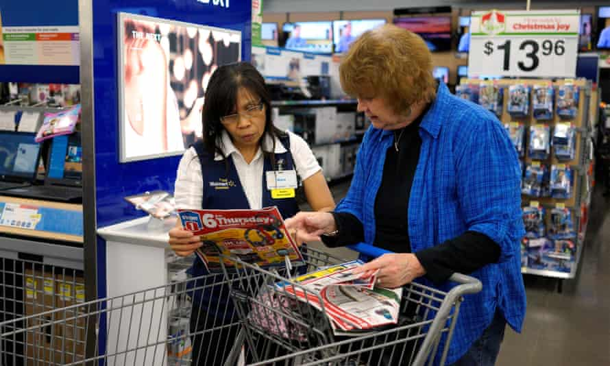 A Walmart employee helps a customer in Colorado. The retail sector has been the biggest job loser for the last two years, and women are bearing the brunt.