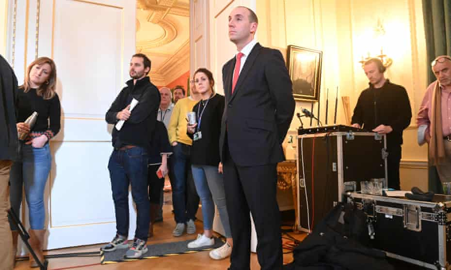 Allegra Stratton (left) and Dan Rosenfield (centre) listen as Johnson holds a remote press conference on Christmas Eve