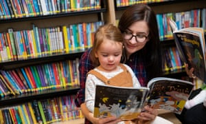 Reader Weronika Williams and three-year-old Zofia in the children's library at Chester's Storyhouse hub.