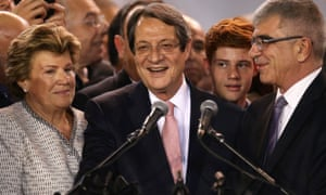 Nicos Anastasiades (centre) with his wife Andri and the chief returning officer, Kypros Kyprianou, during a proclamation ceremony in Nicosia