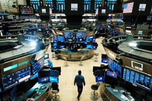 Traders work on the floor at the New York Stock Exchange on 20 March.