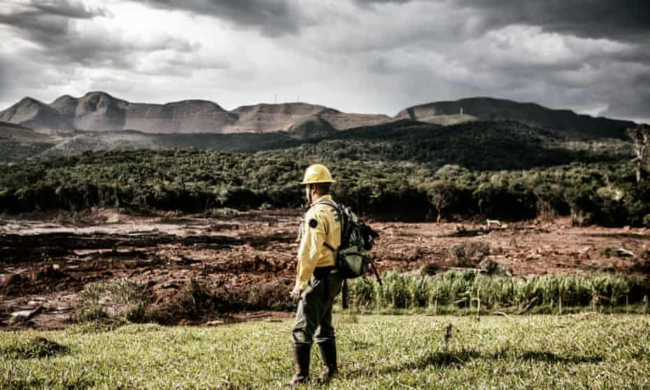 Denis Valerio, volunteer rescue worker, looks at the disaster zone near Corrégo de Feijão.