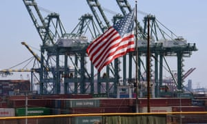 The US flag flies over Chinese shipping containers that were unloaded at the Port of Long Beach in California