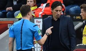 Referee Felix Zwayer sends off Leverkusen's head coach Roger Schmidt.
