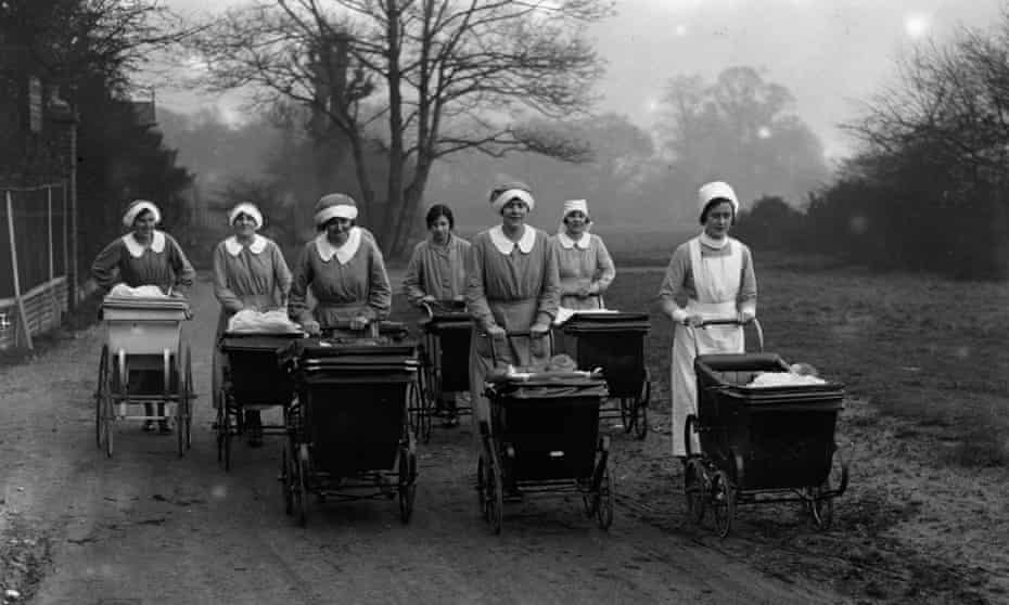 seven women pushing babies in prams in the countryside in 1926