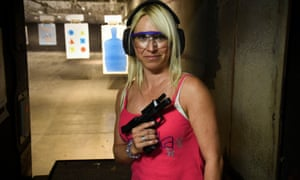 Andrea Hunt, 42, of Howard County holds a 9mm H&K VP9 clip at the Freestate Gun Range in Baltimore.