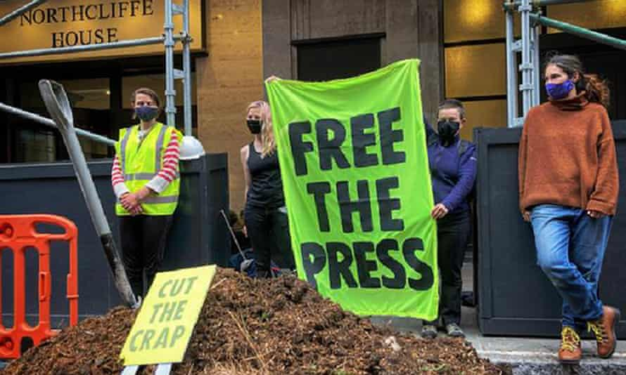 Extinction Rebellion activists hold a demonstration outside Northcliffe House after they dumped manure there.