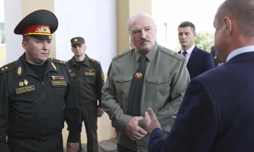 Belarusian president, Alexander Lukashenko (centre), attends a defence meeting in  Shklov