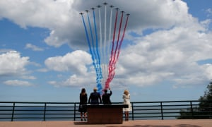 Melania and Donald Trump and Emmanuel and Brigitte Macron watch a flypast.