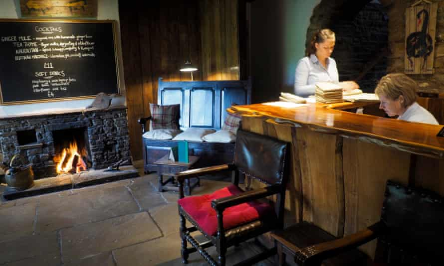 An open fire welcomes customers.
