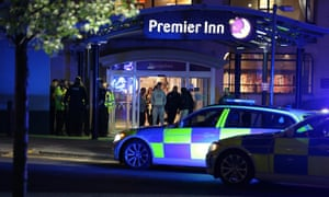 Armed officers guard outside the Premier Inn hotel near the Manchester Arena