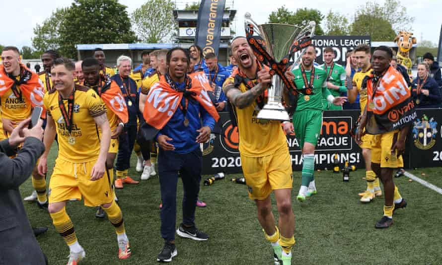 Sutton enjoy their promotion, which has cost almost £1m in stadium upgrades.