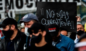 Shopkeepers and business owners protest against coronavirus lockdown measures in Bogota, Colombia, with a banner saying 'No more quarantine'.