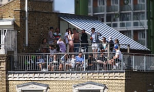 Spectators watch on from a nearby roof terrace during day one of the Bob Willis Trophy match between Surrey and Kent.